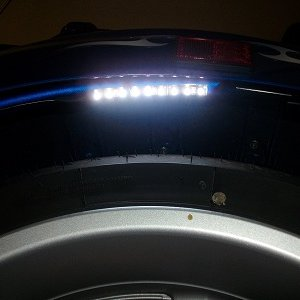 Light under rear fender