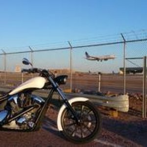 Cool shot of a plane landing in the background at Phoenix airport.