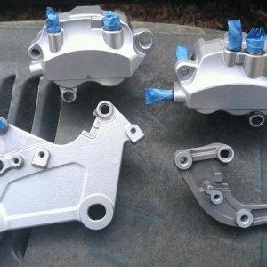 The ABS calipers and brackets all ready for paint. Note dual piston rear caliper on the left and 3 piston front caliper on the right. The center pisto